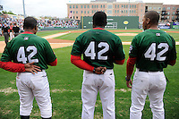 Coaches for Greenville Drive, including manager Carlos Febles, center, wear jersey No. 42 in honor of Brooklyn Dodgers great Jackie Robinson during a game against the West Virginia Power on Monday, April 15, 2013, at Fluor Field at the West End in Greenville, South Carolina.  Betts and the Drive coaches all wore 42 during the game. Robinson's No. 42 was retired in all of baseball in 1997. (Tom Priddy/Four Seam Images)