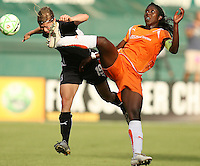 Rebecca Moros #19 of Washington Freedom gets kicked in the head by Anita Asante #5 of Sky Blue FC during a WPS match at RFK Stadium on May 23, 2009 in Washington D.C.