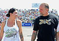 Sept. 23, 2012; Ennis, TX, USA: NHRA funny car driver Alexis DeJoria (left) with television personality Jesse James during the Fall Nationals at the Texas Motorplex. Mandatory Credit: Mark J. Rebilas-US PRESSWIRE