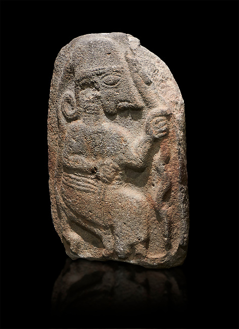 Hittite monumental relief sculpture of a seated figure. Late Hittite Period - 900-700 BC. Adana Archaeology Museum, Turkey. Against a black background