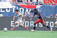 FOXBOROUGH, MA - JULY 25: Joaquín Torres #18 of CF Montreal brings the ball forward during a game between CF Montreal and New England Revolution at Gillette Stadium on July 25, 2021 in Foxborough, Massachusetts.
