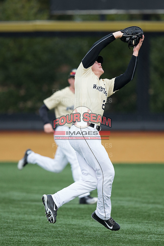 Wake Forest Demon Deacons first baseman Gavin Sheets (24) catches a pop fly down the right field line during the game against the Harvard Crimson at David F. Couch Ballpark on March 5, 2016 in Winston-Salem, North Carolina.  The Crimson defeated the Demon Deacons 6-3.  (Brian Westerholt/Four Seam Images)