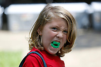 Waylon Sisco, 9, displays his new teeth Friday, July 30, 2021, that he received at the City of Fayetteville Community Resources booth during the annual CDBG in the Park picnic at Walker Park in Fayetteville. The city's Community Development Block Grant program received $748,785 from the federal government this year and pays for a variety of programs, including housing rehabilitation, taxi passes, Ranger's Pantry AniMeals and the Hearth program to house residents. Check out nwaonline.com/210731Daily/ and nwadg.com/photos for a photo gallery.(NWA Democrat-Gazette/David Gottschalk)