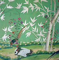 Brightly coloured birds, flowers and bamboo decorate this hand-painted Chinese wallpaper which dates from the 1830s