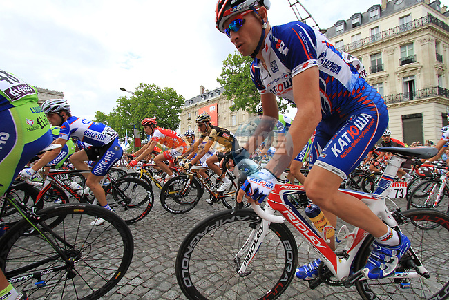 The peloton including Serguei Ivanov (RUS) Katusha rounds the Arc de Triomphe hairpin for the first time during the final Stage 20 of the 2010 Tour de France running 102.5km from Longjumeau to Paris Champs-Elysees, France. 25th July 2010.<br /> (Photo by Eoin Clarke/NEWSFILE).<br /> All photos usage must carry mandatory copyright credit (© NEWSFILE | Eoin Clarke)