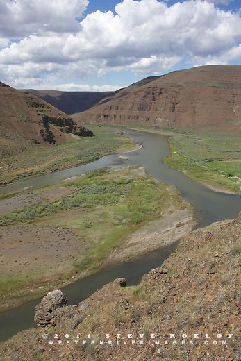 Clouds float above the John Day River, Oregon.
