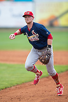 Johnson City Cardinals second baseman Luke Doyle (18) makes a throw to first base against the Bristol Pirates at Boyce Cox Field on July 7, 2015 in Bristol, Virginia.  The Cardinals defeated the Pirates 4-1 in game one of a double-header. (Brian Westerholt/Four Seam Images)