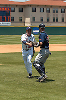 SAN ANTONIO, TX - MAY 13, 2006: County Judge Nelson Wolff throws out the first pitch at Roadrunner Field. (Photo by Jeff Huehn)