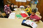 Lao/Greek girl and Greek-american boys at Greek language class in Long Beach, CA, USA.