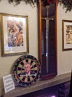 Pictured: A dart board with a picture of First Minister for Wales, Mark Drakeford, at the King Arthur restaurant, in Reynoldston, Wales, UK.<br /> Re: A restaurant has stuck pictures of Wales' First Minister Mark Drakeford on its pumps at the bar and on a dart board, after recent changes to Covid-19 regulations, banned the serving of alcohol and all hospitality businesses closing at 6pm.<br /> The pictures at the King Arthur restaurant in Reynoldston in the Gower Peninsula, show the Welsh politician sipping water from a glass wearing a Santa hat which has been superimposed.