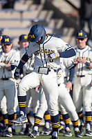 Michigan Wolverines first baseman Jimmy Obertop (8) crosses the plate after hitting his second home run of the NCAA baseball game against the Illinois Fighting Illini at Fisher Stadium on March 19, 2021 in Ann Arbor, Michigan. Illinois won the game 7-4. (Andrew Woolley/Four Seam Images)