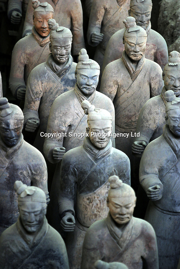 The terracotta army at their excavation site in Xi'an, China. The Qing Dynasty burial site was discovered in 1974 by several local farmers while drilling a well. .02-JAN-04