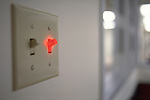glowing red light switch in hospital