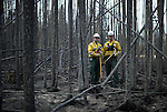 Wildfire Rangers with Alberta Sustainable Resource Development Troy Johanson and Jason McAleenan, part of a strike team, put out hot-spots near the site of the point of origin for the fire around Slave Lake, Alberta on May 19, 2011. Jimmy Jeong / www.jimmyshoots.com