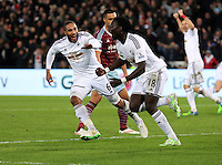 Pictured: Bafetimbi Gomis of Swansea (R) celebrating his equaliser with team captain Ashley Williams (L) Saturday 10 January 2015<br /> Re: Barclays Premier League, Swansea City FC v West Ham United at the Liberty Stadium, south Wales, UK
