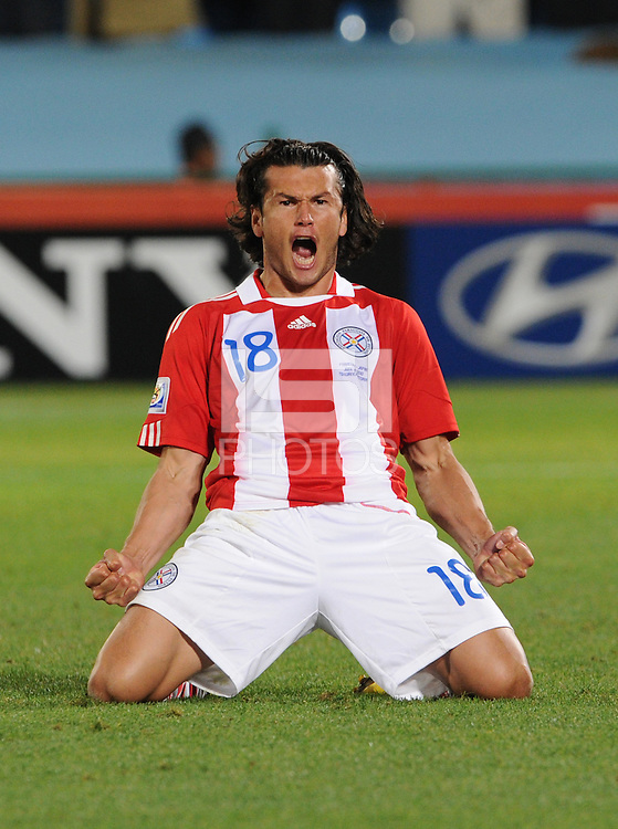 Paraguay's Nelson Valdez celebrates his penalty kick conversion, which guaranteed at least a draw through the first five kicks.Japan and Paraguay played in the second round of the 2010 FIFA World Cup in Loftus Versfeld Stadium, in Pretoria, South Africa, June 29th. After regulation and extra time ended 0-0, Paraguay advanced to the quarterfinals, 5-3, in a penalty-kick shootout.