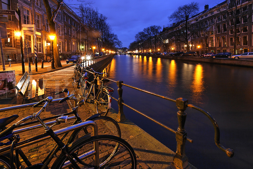 Bicycles on Keizersgracht canal waterfront, Amsterdam, Netherlands<br />