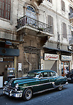 A vintage Pontiac motorcar on the street of the Old City .