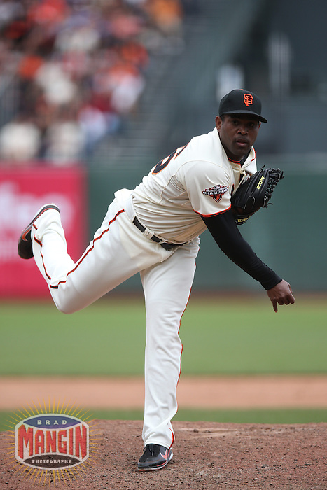 SAN FRANCISCO, CA - MAY 8:  Santiago Casilla #46 of the San Francisco Giants pitches against the Philadelphia Phillies during the game at AT&T Park on Wednesday, May 8, 2013 in San Francisco, California. Photo by Brad Mangin