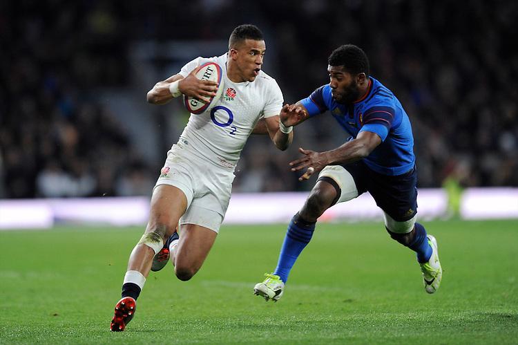 Anthony Watson of England looks to go round Noa Nakaitaci of France