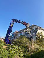 BNPS.co.uk (01202) 558833. <br /> Pic: AshleyFaull/BNPS<br /> <br /> Pictured: The 'old' £6m house being demolished. <br /> <br /> A wealthy homeowner has made the 'brave' decision to demolish his £6m seaside mansion that has its own indoor pool, gym and cinema. <br /> <br /> Ashley Faull has flattened the 20-year-old luxury house to build nine new flats to meet the increasing demand for housing that has led to a surge in property prices.<br /> <br /> The apartments will be priced between £1.495m to £2.8m.<br /> <br /> The now ruined four-storey and 19-room home sits on a half-an-acre plot that backs on to Poole Harbour and overlooks exclusive Sandbanks in Dorset.