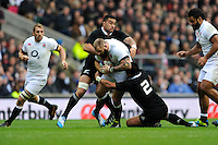 Joe Marler of England is tackled by Keven Mealamu of New Zealand during the QBE Autumn International match between England and New Zealand at Twickenham on Saturday 16th November 2013 (Photo by Rob Munro)