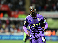 SWANSEA, WALES - MAY 17: Yaya Toure of Manchester City celebrates his second goal making the score 3-2 to his team during the Premier League match between Swansea City and Manchester City at The Liberty Stadium on May 17, 2015 in Swansea, Wales. (photo by Athena Pictures/Getty Images)