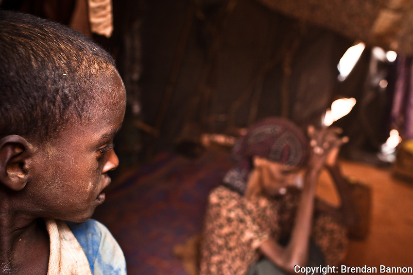 A young Somali refugee boy looks back at his terminally ill mother, Haretha Abdi.