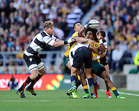 Henry Speight of Australia offloads as he is tackled during the Killik Cup match between Barbarians and Australia at Twickenham Stadium on Saturday 1st November 2014 (Photo by Rob Munro)