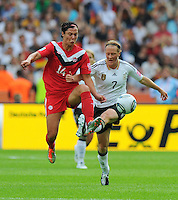 Melanie Behringer (r) of Germany and Melissa Tancredi of Canada during the FIFA Women's World Cup at the FIFA Stadium in Berlin, Germany on June 26th, 2011.