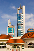 Private house and tall modern tower blocks on Sheikh Zayed Road, the main road between Dubai and Abu Dhabi. Dubai. United Arab Emirates.