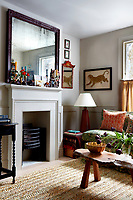 A contemporary fire surround with a Victorian-style grate is the focus of this small living room