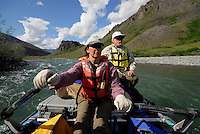 Georgia Bennett rows through a fast stretch of the Kongakut River, with Edward Bennett behind her, in Alaska's Arctic National Wildlife Refuge.