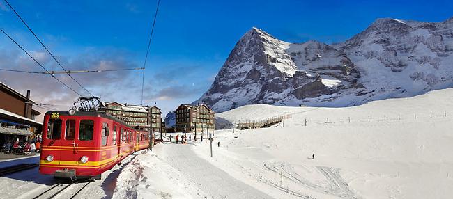 Panoramic of Jungfraujoch train at Kleiner Scheidegg in winter snow with The Eiger (left) then The Monch Mountains. Swiss Alps Switzerland