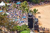 Crowds of spectators on the beach watch the 2016 Big Wave Eddie Aikau Contest, Waimea Bay, North Shore, O'ahu.