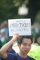 A fan holds a sign asking for tickets for the final game outside the FIFA World Cup Final. The game was held at the Olympic Stadium in Berlin, Germany on Sunday July 9th, 2006. Italy won on penalty-kicks, 5-3, over France after the match ended up in a draw in regulation and extra time