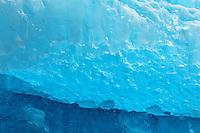 Closeup of blue glacial ice on iceberg floating in Tracy Arm, Southeast Alaska, USA