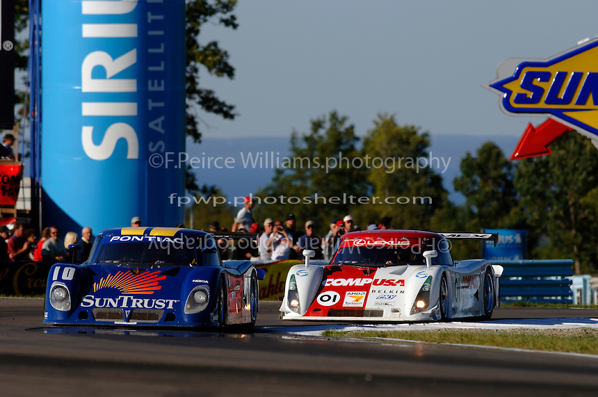 The #10 SunTrust Racing Pontiac/Riley of Max Angelelli leads the #01 Chip Ganassi Racing with Felix Sabates Lexus/Riley of Scott Pruett in the closing laps.