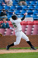 Anderson Gomez (26) of the Winston-Salem Warthogs follows through on a 2-run home run versus the Frederick Keys at Ernie Shore Field in Winston-Salem, NC, Sunday, April 20, 2008.