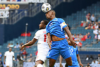 KANSASCITY, KS - JULY 11: Sebastien Cretinoir #21 of Martinique wins the header against Junior Hoilett #10 of Canada during a game between Canada and Martinique at Children's Mercy Park on July 11, 2021 in KansasCity, Kansas.