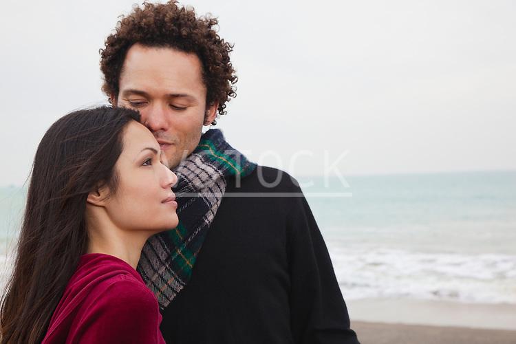 USA, California, San Francisco, Baker Beach, couple embracing on beach