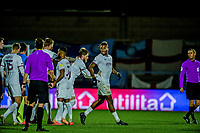 21st November 2020; Adams Park Stadium, Wycombe, Buckinghamshire, England; English Football League Championship Football, Wycombe Wanderers versus Brentford; Ivan Toney is yellow carded at the end of the game and moved away by his team mates.