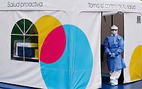 BOGOTA, COLOMBIA - MAY 13:  A nurse waits in a COVID-19 drive-through test point on May 13, 2020 in Bogota. The drive-through test point, the first in Colombia, had a capacity to take 1,400 Covid-19 test a month with a cost of $50 dollars to every patient. (Photo by Leonardo Munoz/VIEWpress via Getty Images)