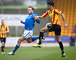 St Johnstone v Partick Thistle...29.03.14    SPFL<br /> Stevie May is tackled by Gabriel Piccolo<br /> Picture by Graeme Hart.<br /> Copyright Perthshire Picture Agency<br /> Tel: 01738 623350  Mobile: 07990 594431