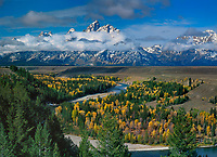 74945028 clouds from a clearing autumn storm surround the tetons mountains with the snake river and fall colored aspens in the foreground from the snake river overlook grand tetons national park wyoming