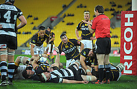 Referee Glen Jackson calls a scrum after the ball is held up over the line during the ITM Cup rugby union match between Wellington Lions and Hawkes Bay at Westpac Stadium, Wellington, New Zealand on Tuesday, 28 August 2012. Photo: Dave Lintott / lintottphoto.co.nz