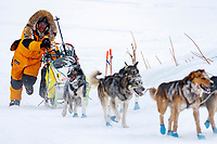 Michi Konno runs up the bank of the Yukon River and into  the Kaltag village checkpoint on Sunday morning March 11th during the 2018 Iditarod Sled Dog Race -- Alaska<br /> <br /> Photo by Jeff Schultz/SchultzPhoto.com  (C) 2018  ALL RIGHTS RESERVED