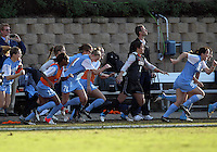 SAN DIEGO, CA - DECEMBER 02, 2012:  Players of the University of North Carolina run onto the field at the end of the NCAA 2012 women's college championship match, at Torero Stadium, in San Diego, CA, on Sunday, December 02 2012. Carolina won 4-1.
