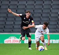 Lincoln City's Conor McGrandles battles with Milton Keynes Dons' Matthew Sorinola<br /> <br /> Photographer Chris Vaughan/CameraSport<br /> <br /> The EFL Sky Bet League One - Milton Keynes Dons v Lincoln City - Saturday 19th September 2020 - Stadium MK - Milton Keynes<br /> <br /> World Copyright © 2020 CameraSport. All rights reserved. 43 Linden Ave. Countesthorpe. Leicester. England. LE8 5PG - Tel: +44 (0) 116 277 4147 - admin@camerasport.com - www.camerasport.com