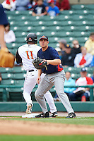 Toledo Mudhens first baseman Chad Huffman (17) waits for a throw as Jorge Polanco (11) runs through the bag during a game against the Rochester Red Wings on June 12, 2016 at Frontier Field in Rochester, New York.  Rochester defeated Toledo 9-7.  (Mike Janes/Four Seam Images)